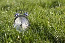Free Clock In  Grass Stock Photo - 26910590
