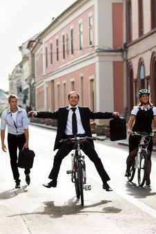 Free Businesspeople Riding On Bikes And Running Stock Photography - 26913572