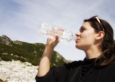 Free Woman Drinking Crystal Clear Water From Bottle Royalty Free Stock Image - 26913766