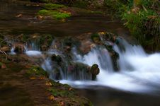 Peacefully Flowing Stream And Autumn Foliage Royalty Free Stock Photos