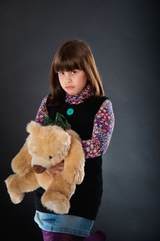 Free Sad Girl Playing With A Teddy Bear Stock Images - 26926434