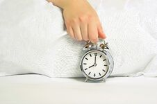 Free Woman Holding The Alarm Clock Royalty Free Stock Photos - 26928568