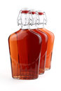 Free Whiskey In Old-fashioned Bottles Stock Image - 26930171