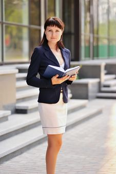 Woman With A Notebook Stock Photos
