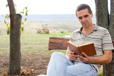 Man Enjoying A Book In The Garden Stock Images
