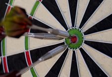 Free Darts In The Red Bullseye Royalty Free Stock Image - 26975296