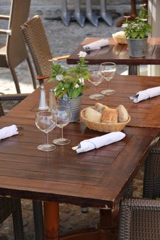 Free Wooden Tables At A Restaurant Royalty Free Stock Image - 26977536