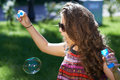 Free Young Girl Blows Soap Bubbles Stock Images - 26988444