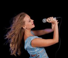 Free Girl Singing In Microphone Royalty Free Stock Photography - 26981957