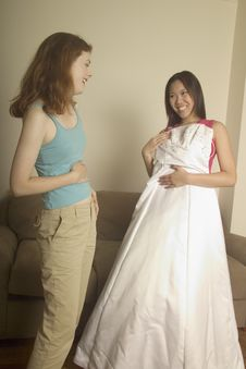 Free Girl Shows Her Friend Her Wedding Dress Royalty Free Stock Photography - 279527