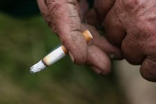 Cigarette In Hand Stock Photos