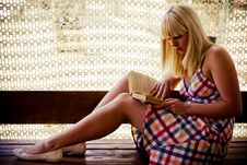 Free Young Blonde Girl Reading Royalty Free Stock Photo - 2704645