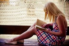 Young Blonde Girl Reading Stock Photo
