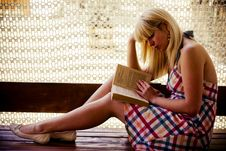 Free Young Blonde Girl Reading Stock Image - 2704651