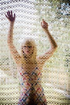 Free Young Blonde Girl Behind A Net Royalty Free Stock Image - 2704656
