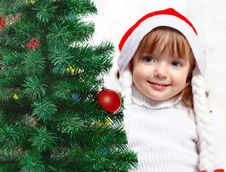 Free Beautiful Girl Dressed In A Santa Claus Hat Royalty Free Stock Photo - 27017885