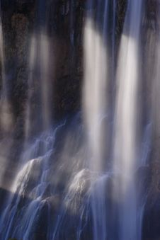 Light Beams Across Waterfall Royalty Free Stock Photos
