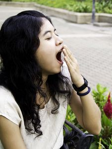Free Young Beautiful Brunette Woman Yawning Royalty Free Stock Photos - 27024458