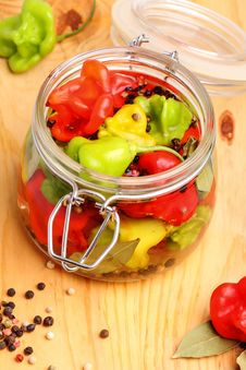 Fresh And Canned Hot Peppers Stock Photography