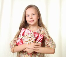 Free Little Blond Girl Holding A Red Glamorous Gift Royalty Free Stock Image - 27030236