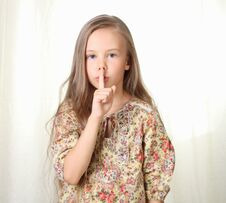 Free Little Blond Girl Keepeing Silence Royalty Free Stock Photos - 27030248