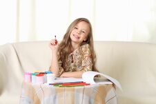 Free Little Blond Girl Drawing At Home On Sofa Royalty Free Stock Image - 27030326