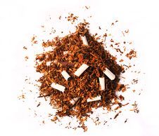 Pile Of Tobacco Leaves With Broken Cigarettes Royalty Free Stock Photography