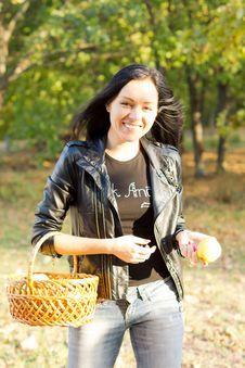 Free Woman Carrying Basket And Apple Stock Image - 27036021