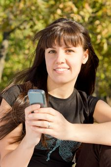 Free Woman Holding Mobile Phone Stock Images - 27036064