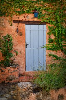 Free Old Blue Door In Orange Wall Stock Photography - 27042302