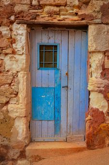 Free Old Textured Door In A Stone Wall Royalty Free Stock Images - 27042329