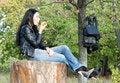 Free Woman Sitting Enjoying An Apple Stock Image - 27051061