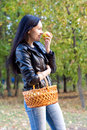 Free Attractive Girl With Basket Eating An Apple Royalty Free Stock Image - 27054066
