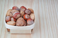 Free Basket With Wood, Walnuts And Almonds. Royalty Free Stock Photos - 27057308