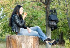 Free Woman Sitting Enjoying An Apple Stock Image - 27051061
