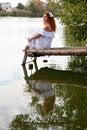 Free Bride Sitting On Wooden Bridge Royalty Free Stock Photos - 27064488