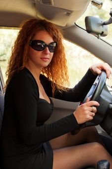 Red-haired Woman Driving Car Stock Image