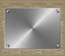 Free Metal Plate On Wooden Background Royalty Free Stock Photos - 27067158