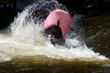 Free A Pink Kayak Flips As A Paddler Does His Stunts. Royalty Free Stock Images - 27075159