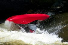 Free A Red Kayak Flips As A Paddler Does His Stunts. Royalty Free Stock Photos - 27075338