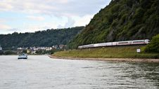 Free Train Travelling Along Rhine River Stock Photos - 27077143