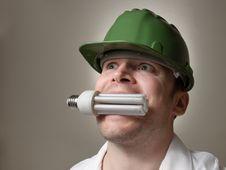 Free Engineer With Energy Saving Lightbulb Royalty Free Stock Photography - 27078057