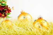 Free Three Christmas Balls On Yellow Tinsel Royalty Free Stock Photos - 27084588