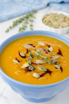 Pumpkin Soup With Pumpkin Oil And Seeds Close-up Royalty Free Stock Photos