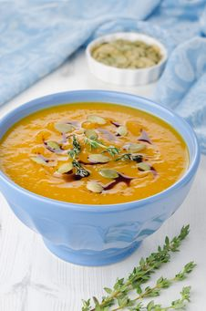 Pumpkin Soup With Pumpkin Oil And Seeds Close-up Stock Images