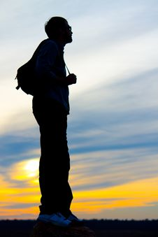 Free Silhouette Of A Man With A Backpack Stock Image - 27100951