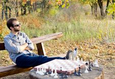 Free Man Relaxing Waiting For A Chess Opponent Royalty Free Stock Image - 27101016