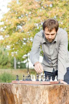 Free Man Playing Chess Outdoors Stock Image - 27101071