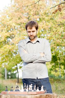 Free Man Contemplating His Next Chess Move Stock Photos - 27101083