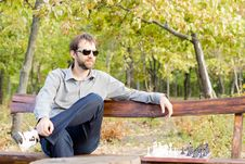 Free Pensive Young Man On A Bench Royalty Free Stock Photography - 27101097